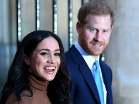 In this file photo taken on January 07, 2020 Britain's Prince Harry, Duke of Sussex and Meghan, Duchess of Sussex react as they leave after her visit to Canada House in thanks for the warm Canadian hospitality and support they received during their recent stay in Canada.