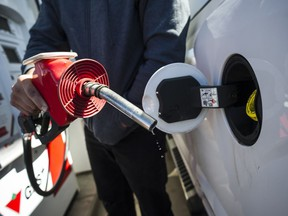 A man fills up his truck with gas in Toronto, on Monday April 1, 2019. As of January 1, every Canadian and all Canadian businesses, are paying a price on carbon. The federal Greenhouse Gas Pollution Pricing Act, means provinces which do not have their own price on pollution that meets a federal standard get the federal carbon tax applied to them.THE CANADIAN PRESS/Christopher Katsarov