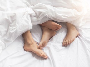A couple in bed. A study has found that a healthy sex life could delay menopause.