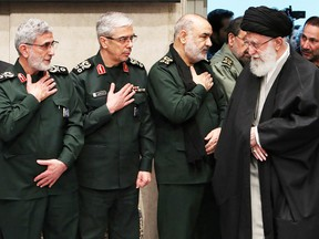 Iran's Supreme Leader Ayatollah Ali Khamenei greets, from left, newly appointed commander of the Quds Force of the Islamic Revolutionary Guard Corps Esmail Qaani, Iranian Armed Forces Chief of Staff Major General Mohammad Bagheri and Iranian Islamic Revolutionary Guard Corps (IRGC) Chief Commander Hossein Salami at a mourning ceremony in Tehran for slain top general Qassem Soleimani on Jan. 9.