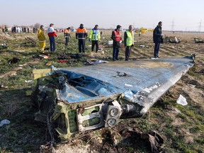 Rescue teams at the scene of a Ukrainian airliner crash near Imam Khomeini airport in the Iranian capital Tehran, Jan. 8, 2020.