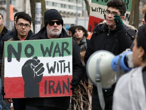 Demonstrators protest against war amid increased tensions between the United States and Iran, outside the United States consulate in Toronto, Ontario, Canada January 4, 2020.