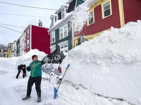 Residents dig out their car in St. John's on Sunday, Jan. 19, 2020. The state of emergency ordered by the City of St. John's continues, leaving businesses closed and vehicles off the roads in the aftermath of the major winter storm that hit the Newfoundland and Labrador capital.