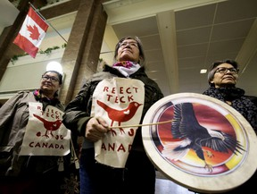 Members of Beaver Hills Warriors and Extinction Rebellion Edmonton protest further expansion of the oil sands, specifically the Teck Frontier Mine, inside Canada Place, in Edmonton Wednesday Jan. 22, 2020.