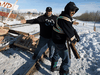 A protester tries to block counter protesters from tearing down a blockade along the CN rail line in Edmonton, Feb. 19, 2020.