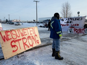 Protesters block a CN rail line near 213 Street and 110 Avenue in Edmonton on Feb. 19, 2020.