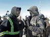 A counter protester argues with a protester as supporters of the indigenous Wet'suwet'en Nation's hereditary chiefs camp at a blockade along the CN rail line in Edmonton, Feb. 19, 2020.
