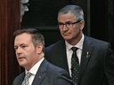 Alberta Premier Jason Kenney and Alberta Finance Minister Travis Toews arrive to deliver the provincial budget speech on Feb. 27, 2020.