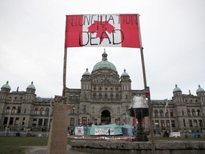 Wet'suwet'en protesters camp out in front of legislature before the speech from the throne in Victoria, B.C., on Tuesday, February 11, 2020.