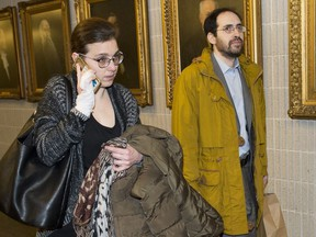 Clara Wasserstein, left, and Yochonon Lowen arrive at courthouse in Montreal on February 10, 2020. The lawyer for a couple who left their ultra-Orthodox Hasidic community is telling a courtroom that the Jewish schools operating north of Montreal are illegal and leave no time for secular education. In his closing arguments today, Bruce Johnston told Superior Court Justice Martin Castonguay that the judge can push the Quebec government to do something to fix that situation. Johnston is representing Yochonon Lowen and his wife Clara Wasserstein, who have filed legal action against the Quebec government and ultra-Orthodox Hasidic schools in Boisbriand, Que.