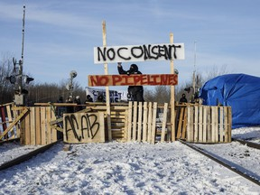 Supporters of the Wet'suwet'en who are against the LNG pipeline, block a CN Rail line just west of Edmonton on Wednesday February 19, 2020.