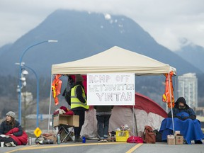 Protesters block the road access to one of Vancouver's port entrances in Vancouver Sunday, February 9, 2020. The protesters who are standing in solidarity with the Wet'suwet'en members opposed to the LNG pipeline in northern British Columbia are on day 4 of blocking the main ports in Vancouver.