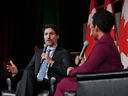 Prime Minister Justin Trudeau speaks with broadcast journalist Marci Ien at a Black History Month reception at the National Arts Centre in Ottawa, on Feb. 24, 2020.