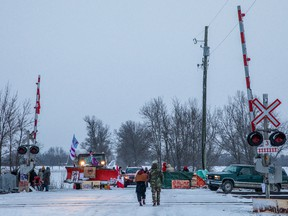 Demonstrators stand near railway tracks during a protest near Belleville, Ont., on Feb. 13, 2020.