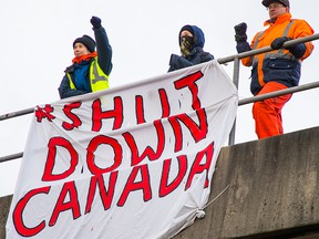 Activists protest in Port Coquitlam, B.C., on Feb. 13, 2020.