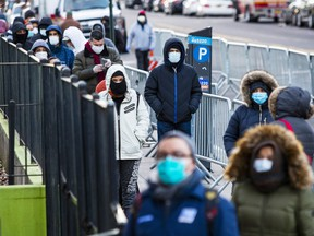 People line up to get a test at Elmhurst Hospital due to coronavirus outbreak on March 24, 2020 in Queens, New York, United States. There are now more than 35,000 cases of COVID-19 in the United States as governments scramble to contain the spread.