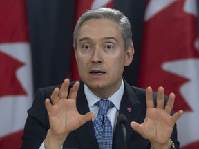 Foreign Affairs Minister Francois-Philippe Champagne responds to a question during a news conference in Ottawa, Monday, March 9, 2020.
