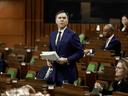 Finance Minister Bill Morneau speaks in the House of Commons as legislators convene to pass a COVID-19 financial aid package, in Ottawa on March 25, 2020.