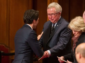 Prime Minister Justin Trudeau speaks with former Prime Minister Joe Clark following the Speech from the Throne in Ottawa, Canada on December 4, 2015.
