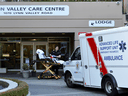 Paramedics leave the Lynn Valley Care Centre, a seniors care home that housed a man who was the first in Canada to die after contracting novel coronavirus, in North Vancouver on March 9, 2020.