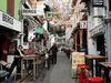 Restaurant staff wait for customers along a largely empty Haji Lane, as tourism takes a decline following the coronavirus outbreak in Singapore March 3, 2020.