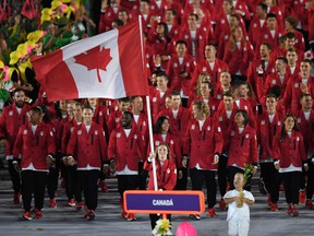 In this file photo taken on August 5, 2016 Canada's flagbearer Rosannagh Maclennan leads her delegation during the opening ceremony of the Rio 2016 Olympic Games at the Maracana stadium in Rio de Janeiro.