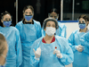 Medical staff prepare to receive patients for coronavirus screening at a temporary assessment centre at a hockey arena in Ottawa on March 13, 2020.