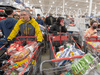 In the wake of the coronavirus pandemic, customers crowd a Costco store in Montreal to stock up on food and supplies, March 13, 2020.