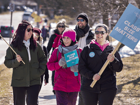 Ontario English Catholic Teachers Association members picket in Brantford as part of a province-wide one-day strike on March 5, 2020.