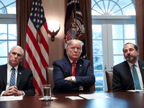 U.S. President Donald Trump is flanked by Vice President Mike Pence and Health and Human Services Secretary Alex Azar at a meeting of the coronavirus task force with pharmaceutical executives at the White House, March 2, 2020.