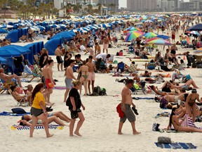 People crowd the beach, while other jurisdictions had already closed theirs in efforts to combat the spread of novel coronavirus disease (COVID-19) in Clearwater, Florida, U.S. March 17, 2020.