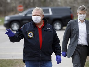 Doug Ford, Ontario's premier, wears a protective mask as he arrives at an event to hand out meals provided by Maple Leaf Sports & Entertainment (MLSE) to healthcare workers outside Centenary Hospital in Toronto on Friday, April 24.