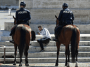 Patrolling mounted police patrol as the spread of COVID-19 continues in Rome, Italy, April 10, 2020.
