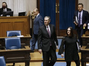 Manitoba Premier Brian Pallister enters an emergency COVID-19 physically distanced session at the Manitoba Legislature in Winnipeg, Wednesday, April 15, 2020.