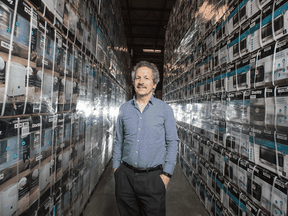 Danby CEO Jim Estill, standing in his company's warehouse in Guelph, Ontario.