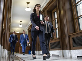 Quebec Health Minister Danielle McCann, Quebec Premier Francois Legault, right, and Horacio Arruda, Quebec director of National Public Health, centre, walk to a daily news conference conference on the COVID-19 pandemic, Wednesday, April 1, 2020 at the legislature in Quebec City.