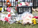 A makeshift shrine honouring Const. Heidi Stevenson is shown outside RCMP headquarters in Dartmouth, N.S., Friday, April 24, 2020.