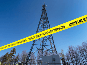 A cellphone tower that was burned on May 7 in Blainville, Que. For some conspiracy theory believers, 5G suppresses the immune system or accelerates the spread of disease and burning down the towers is a heroic act.