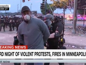 A screengrab of police arresting CNN reporter Oscar Jimenez while he was reporting live on air during the Minneapolis riots, May 29, 2020.