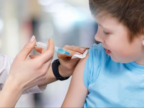 A child receives his vaccine from a pediatrician.