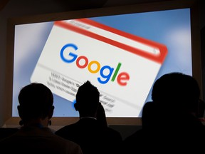 Attendees watch a presentation during a Google Inc. 20th anniversary event in San Francisco, Calif., on Sept. 24, 2018.