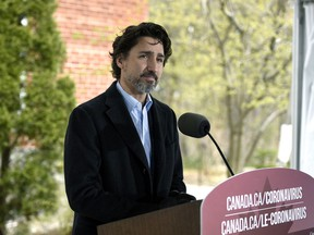 Prime Minister Justin Trudeau listens to a reporter's question during his daily news conference on the COVID-19 pandemic outside his residence at Rideau Cottage in Ottawa, on Saturday, May 9, 2020.