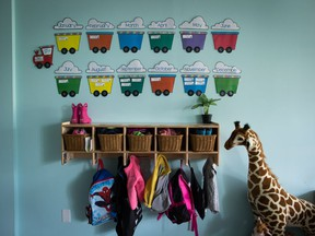 Children's backpacks and shoes are seen at a daycare, in Langley, B.C., on Tuesday May 29, 2018. The federal government has been quietly probing how to provide provinces with more money annually for child care, as part of what sources describe as an issue that is at, or near, the top of the Liberal agenda to restart the economy.