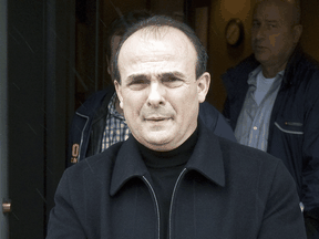 Vincenzo (Jimmy) DeMaria is escorted in handcuffs after his arrest for a parole violation in April 2009.