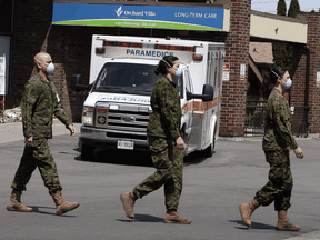 Members of the Canadian Armed Forces in front of Pickering's Orchard Villa long-term care home on May 6, 2020.
