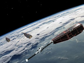 This handout picture released on November 5, 2013 by the European Space Agency (ESA) shows an artist view of the three Swarm satellites.