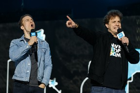 WE co-founders Craig and Marc Kielburger speak during WE Day Alberta at Rogers Place in Edmonton, on Tuesday, Oct. 22, 2019.