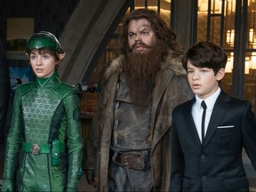 From left, Lara McDonnell, Josh Gad and Ferdia Shaw take in the weirdness in Artemis Fowl.