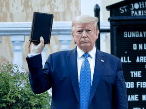 U.S. President Donald Trump holds a Bible while visiting St. John's Church across from the White House after the area was cleared of people protesting the death of George Floyd June 1, 2020.