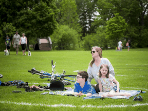 A family enjoys some time outside at Mooney's Bay in Ottawa in May.